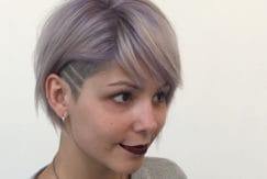 striped undercut designs on woman with lilac hair