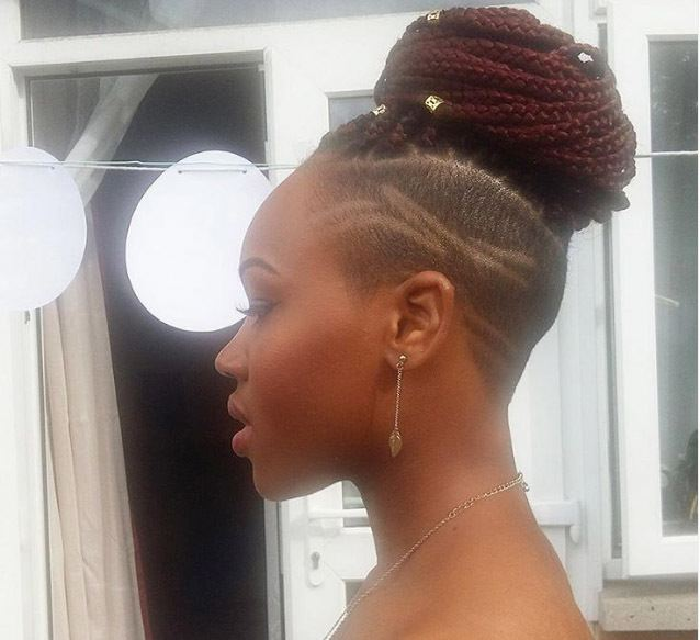 close up of woman with edgy red short box braids