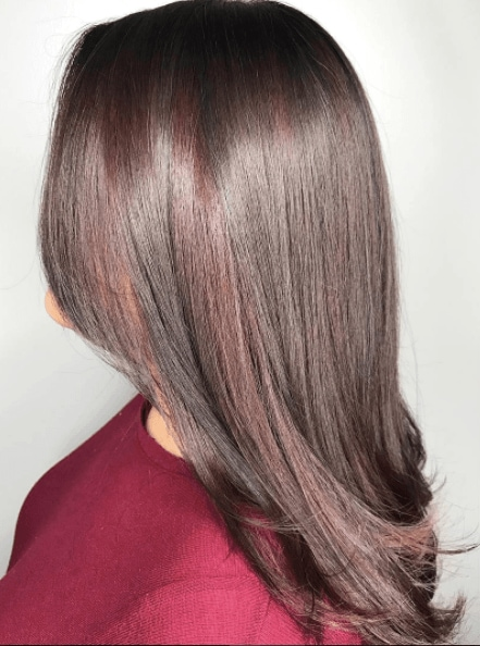Balayage on dark hair with a hint of red