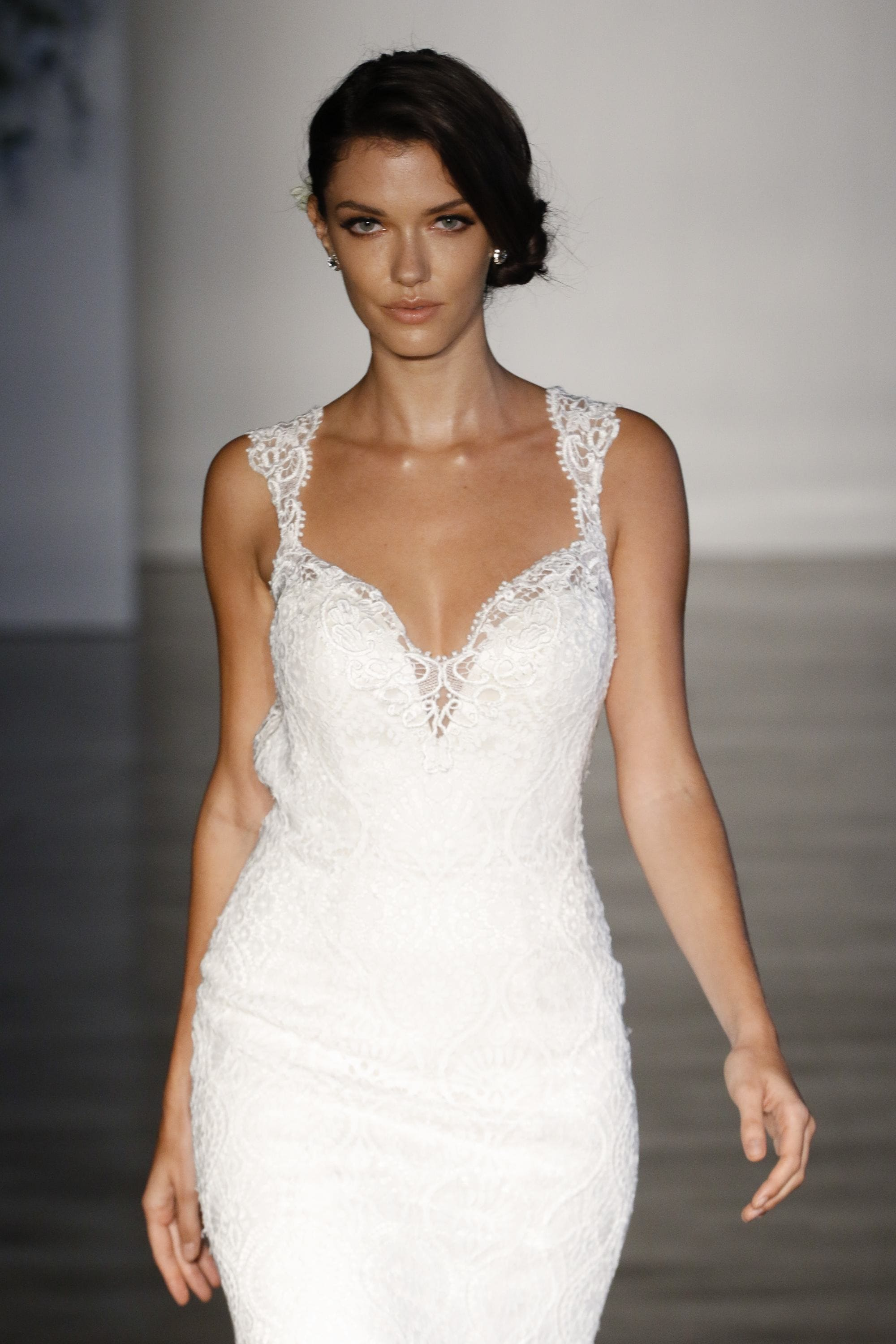 bb2b0b1ed61 brunette bridal model on the runway with a side chignon hairstyle