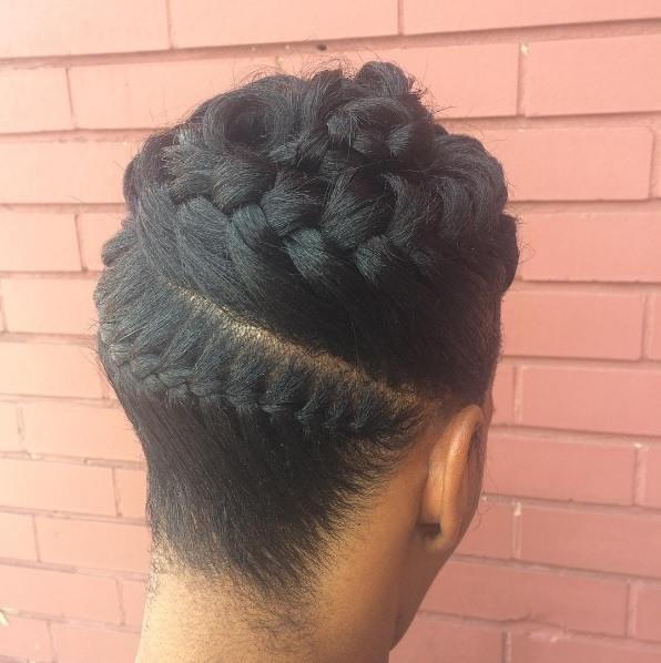 woman with black spiral goddess braids