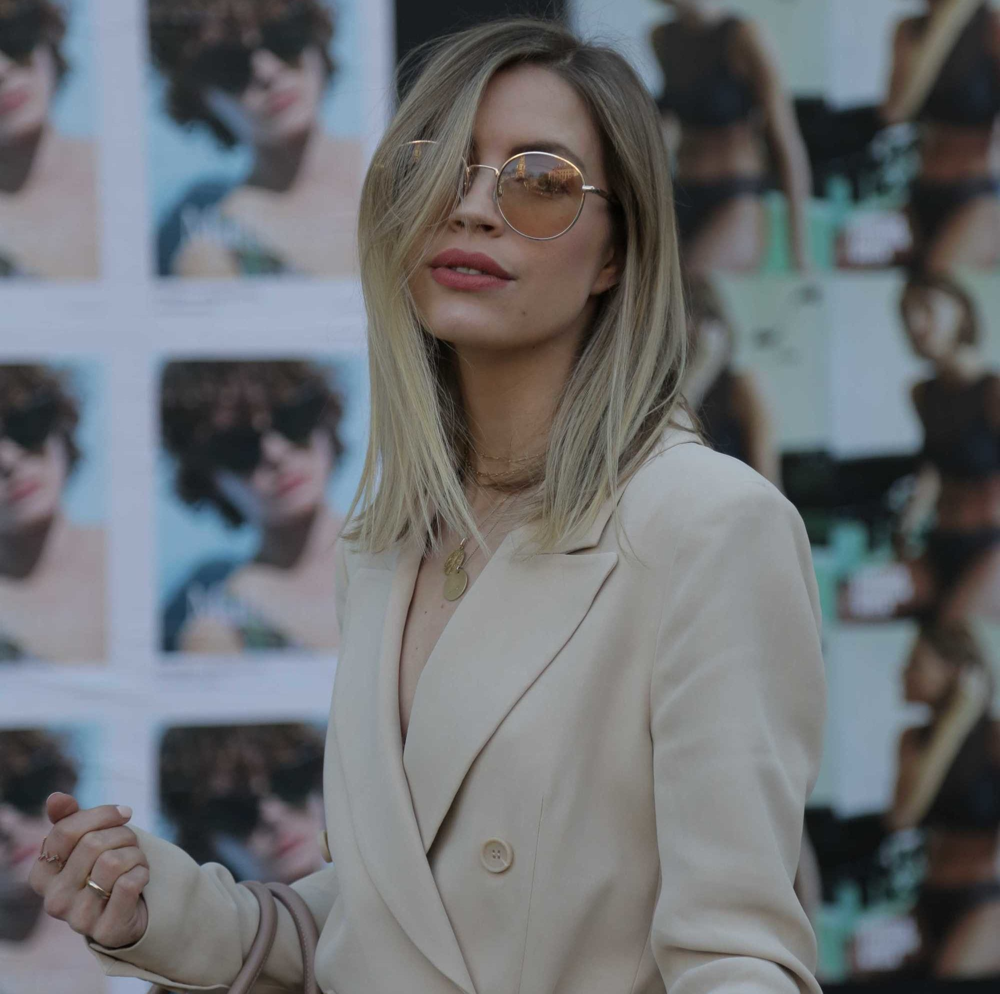 Spring hair colours: Woman with long bob length sandy blonde straight hair, wearing beige
