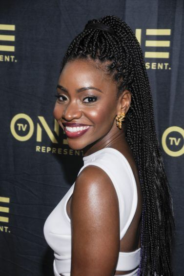 Front view of Teyonah Paris with a braids in a highponytail