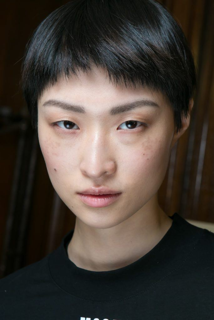 images of short haicuts: a fashionable pixie cut as shown by model backstage