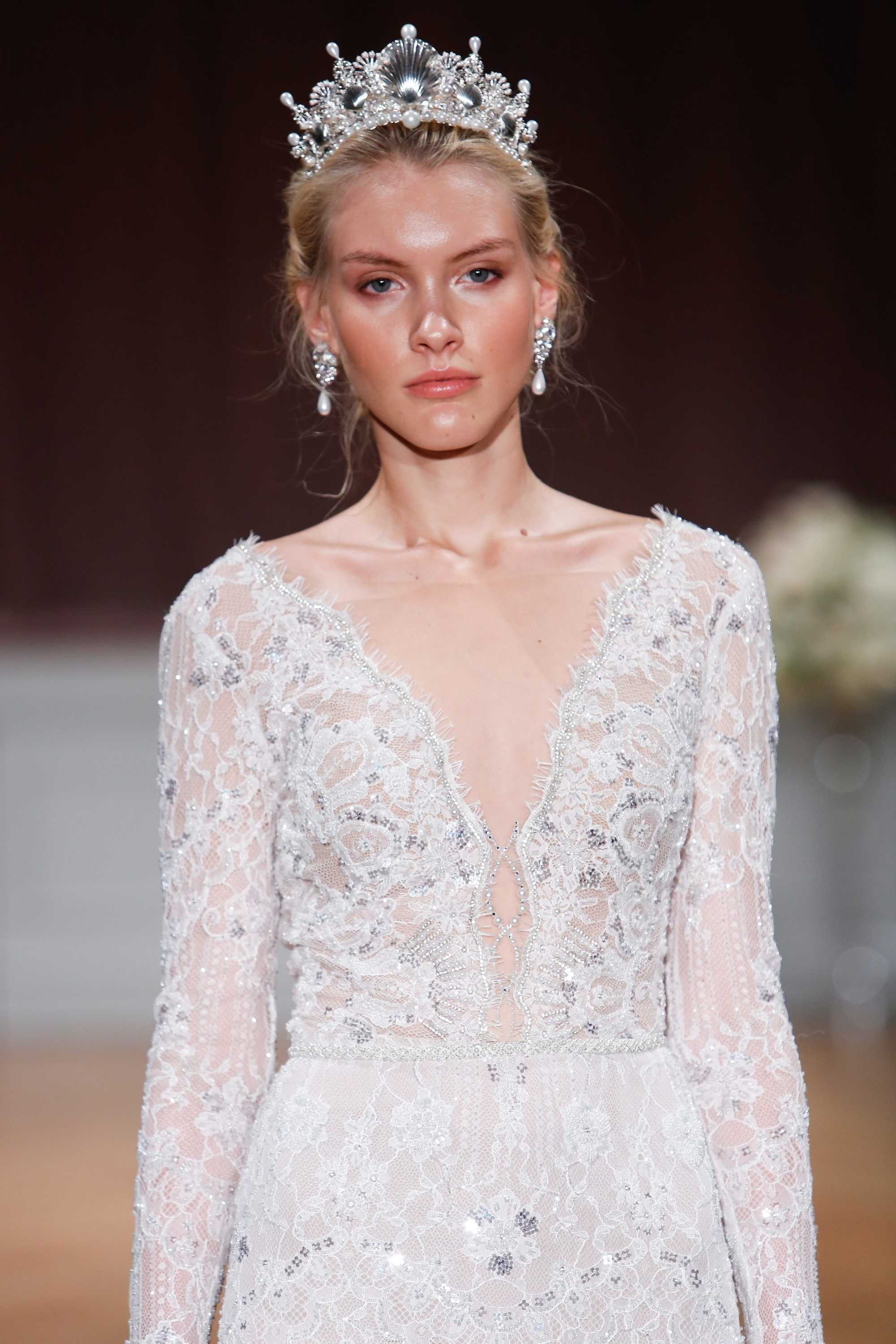 bridal model with a plunging gown and tiara