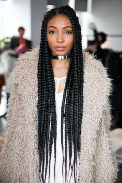 model wynter golden with poetic justice inspired braids with a jacket and collar