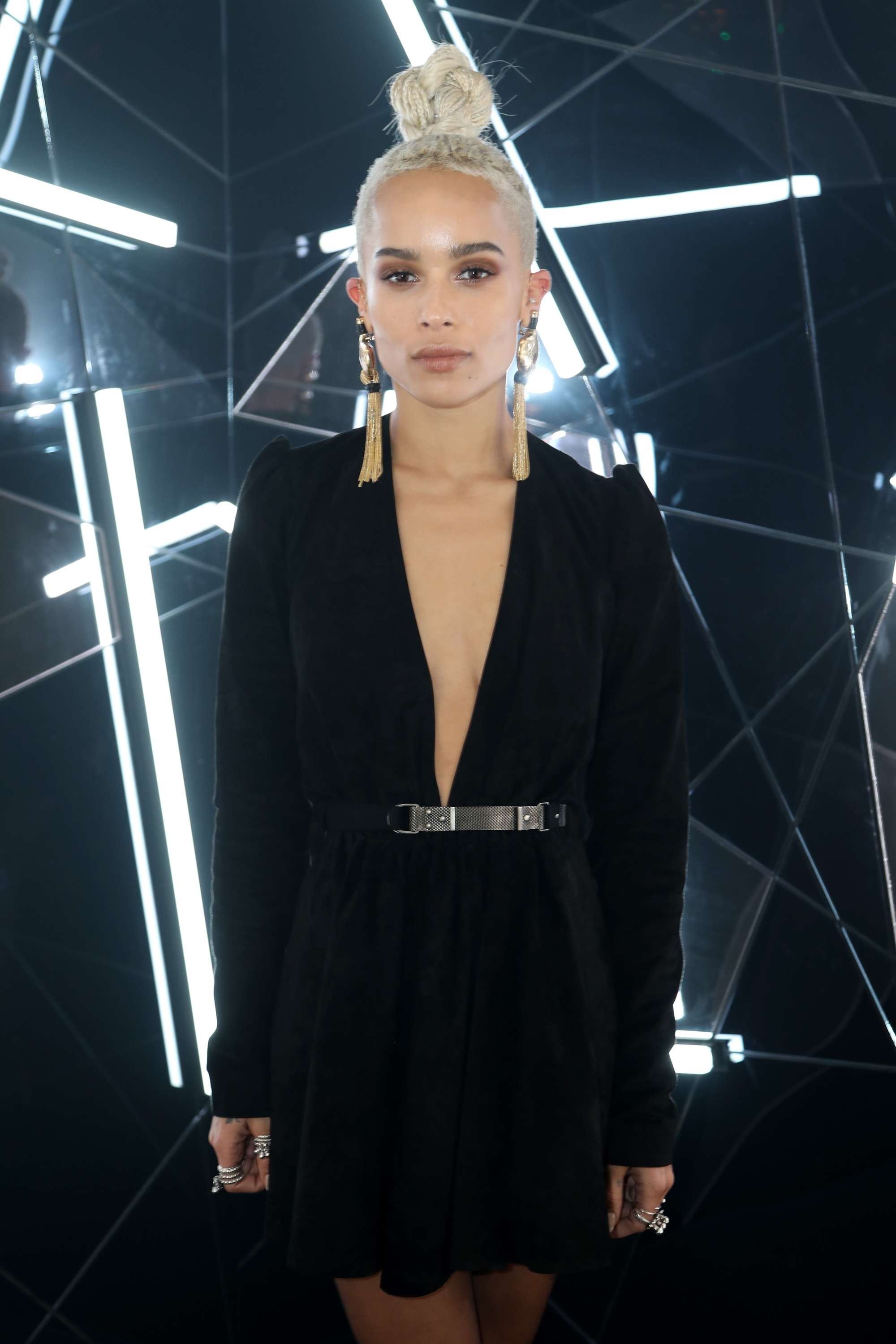 zoe kravitz at ysl event in black dress and top knot undercut hairstyle