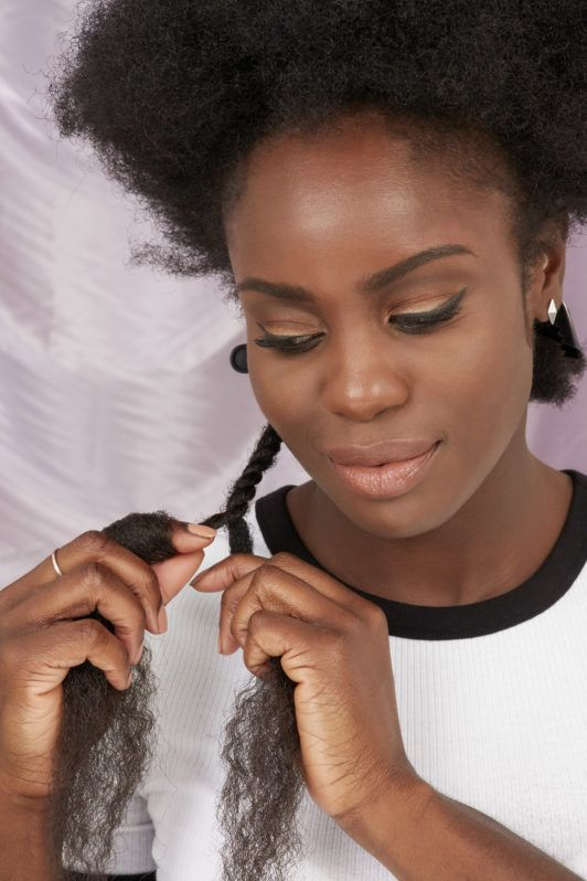 How to do marley braids on yourself: Woman twisting marley braid in the All Things Hair UK Studio
