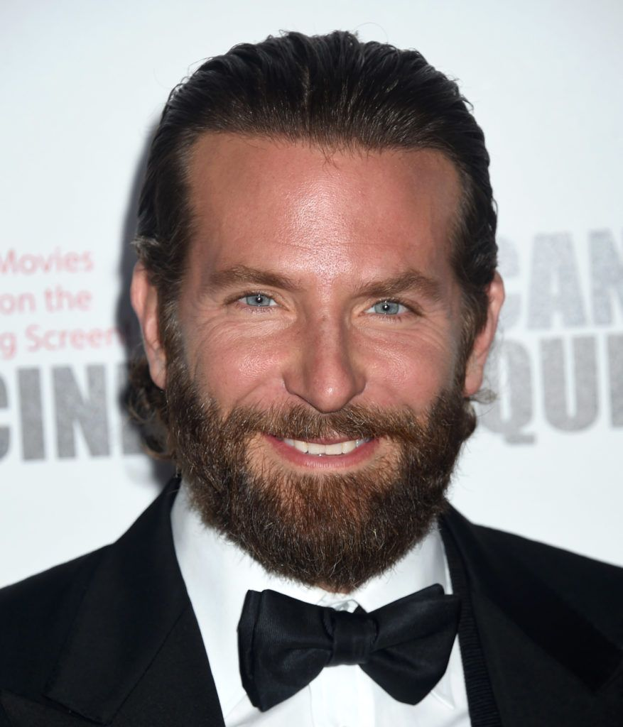 Bradley Cooper On The Red Carpet Wearing A Black And White Suit With Bow Tie