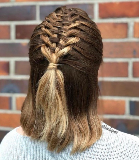 back view image of a woman with short hair and suspended infinity braid