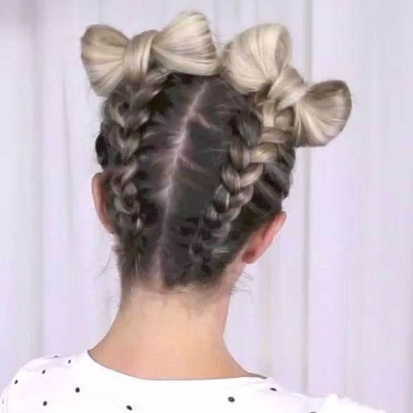 back view of a woman with Dutch braids and bow hairstyle