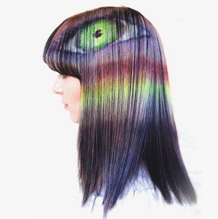 hair model with optical illusion hair designs painted into her brown hair