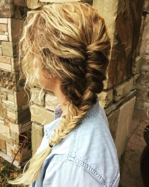 blonde curly hair in a side fishtail braid