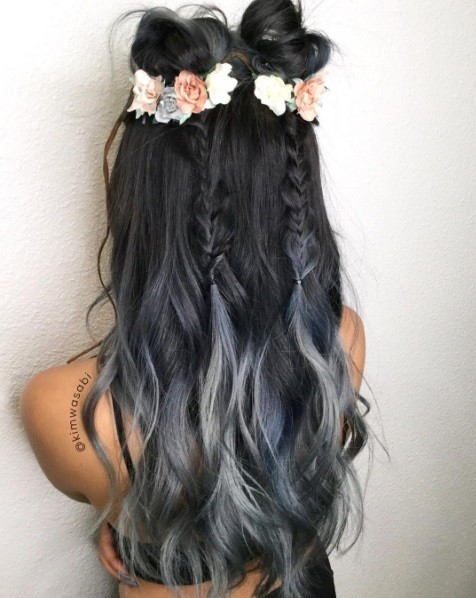 girl with long grey ombre hair with floral braided space buns