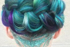 woman with blue hair and glitter undercut