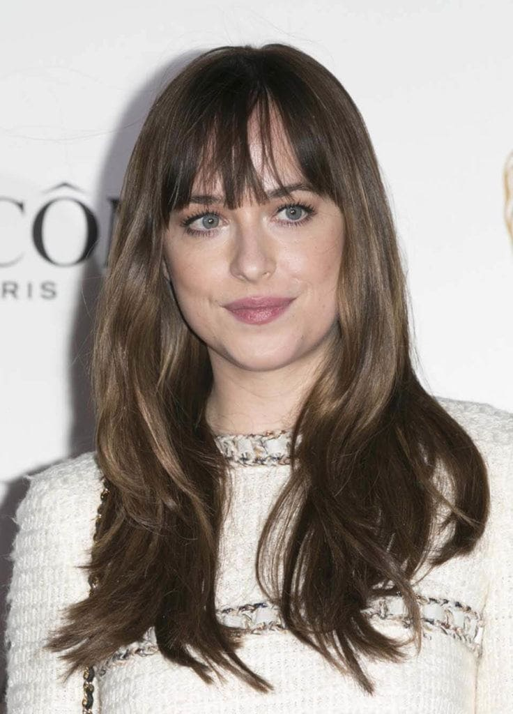 ideas for long hair: Soft wavy layers and a piecier fringe as seen on Dakota Johnson