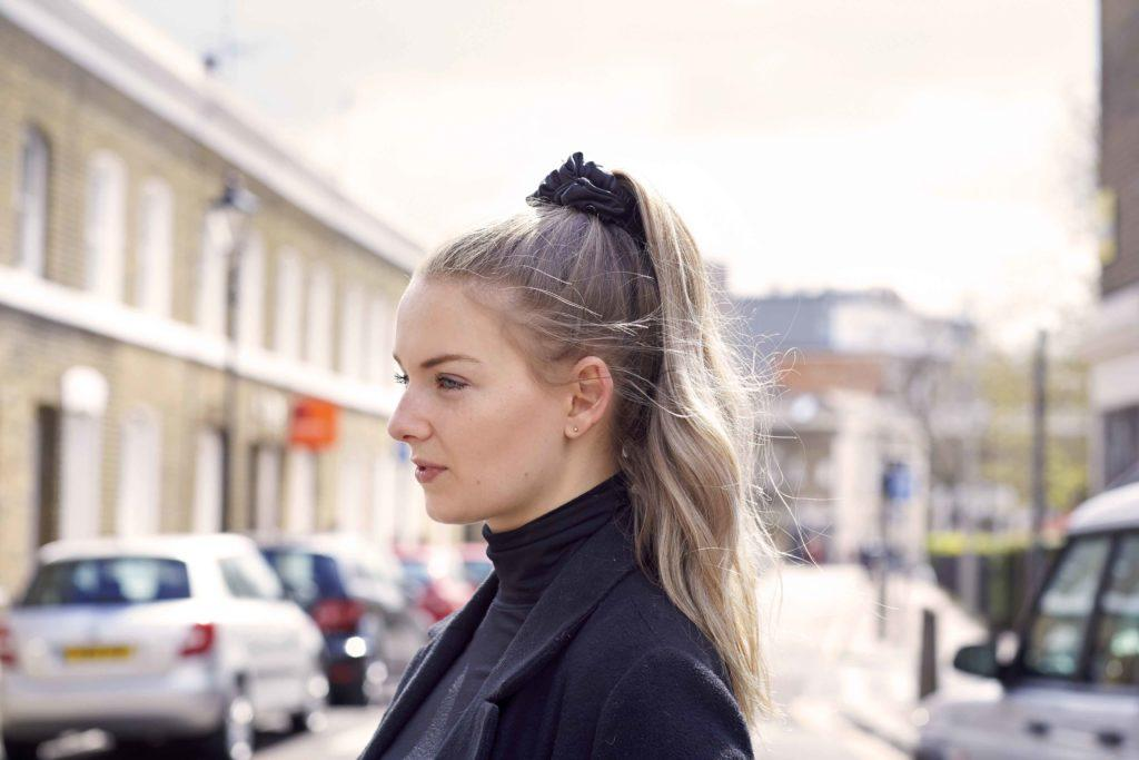 quick hairstyles for long hair: blonde woman with a high ponytail