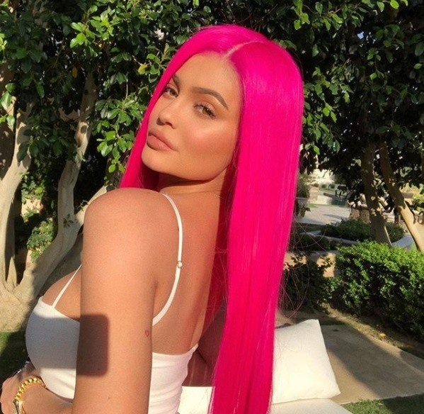 kylie jenner at coachella festival wearing a hot florescent pink long straight wig