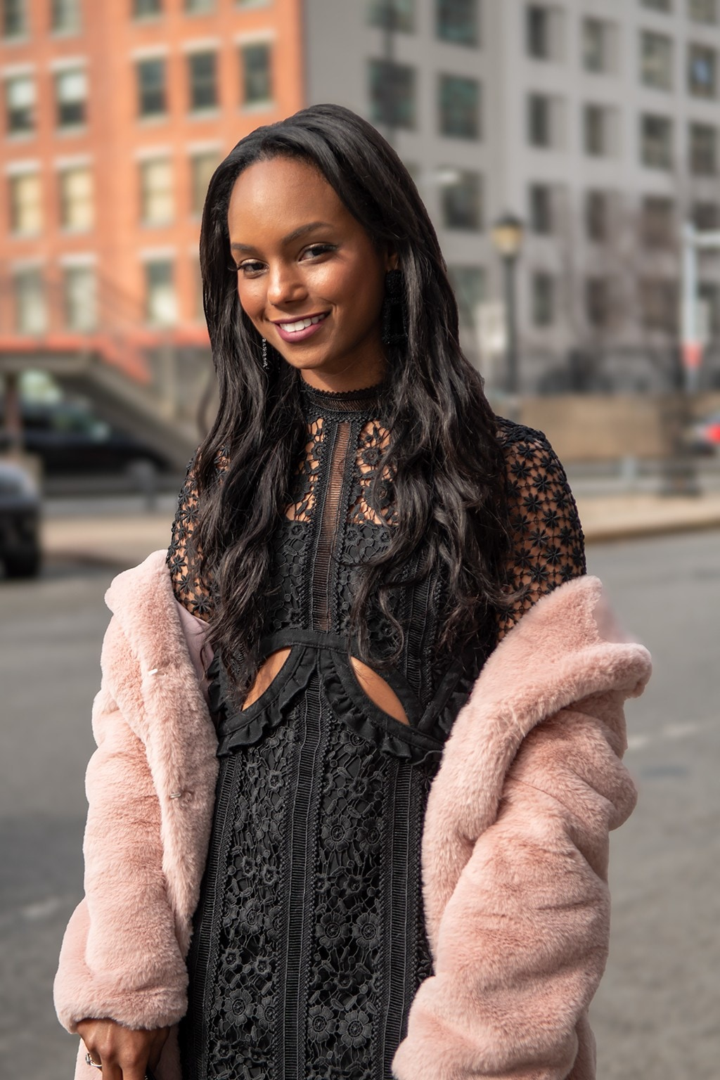 Long hair ideas: Shot of woman with long relaxed natural hair with glam curls at the ends