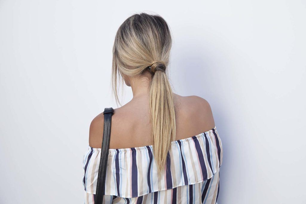 back view of a woman with long blonde hair in a low sleek ponytail - long hairstyles 2017