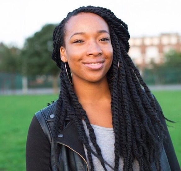 front view of a girl with marley twists in a half up half down style