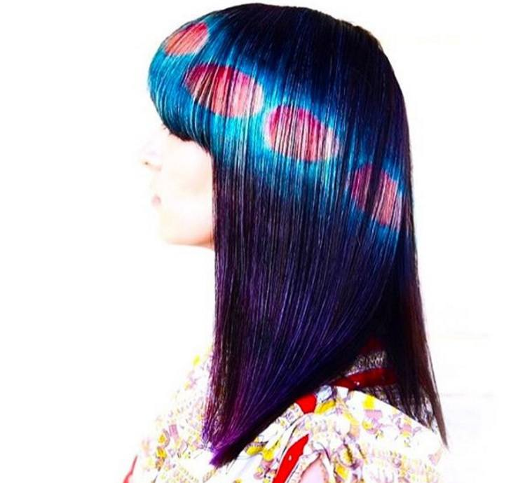 hair model with mars optical illusion hair designs painted into her brown hair