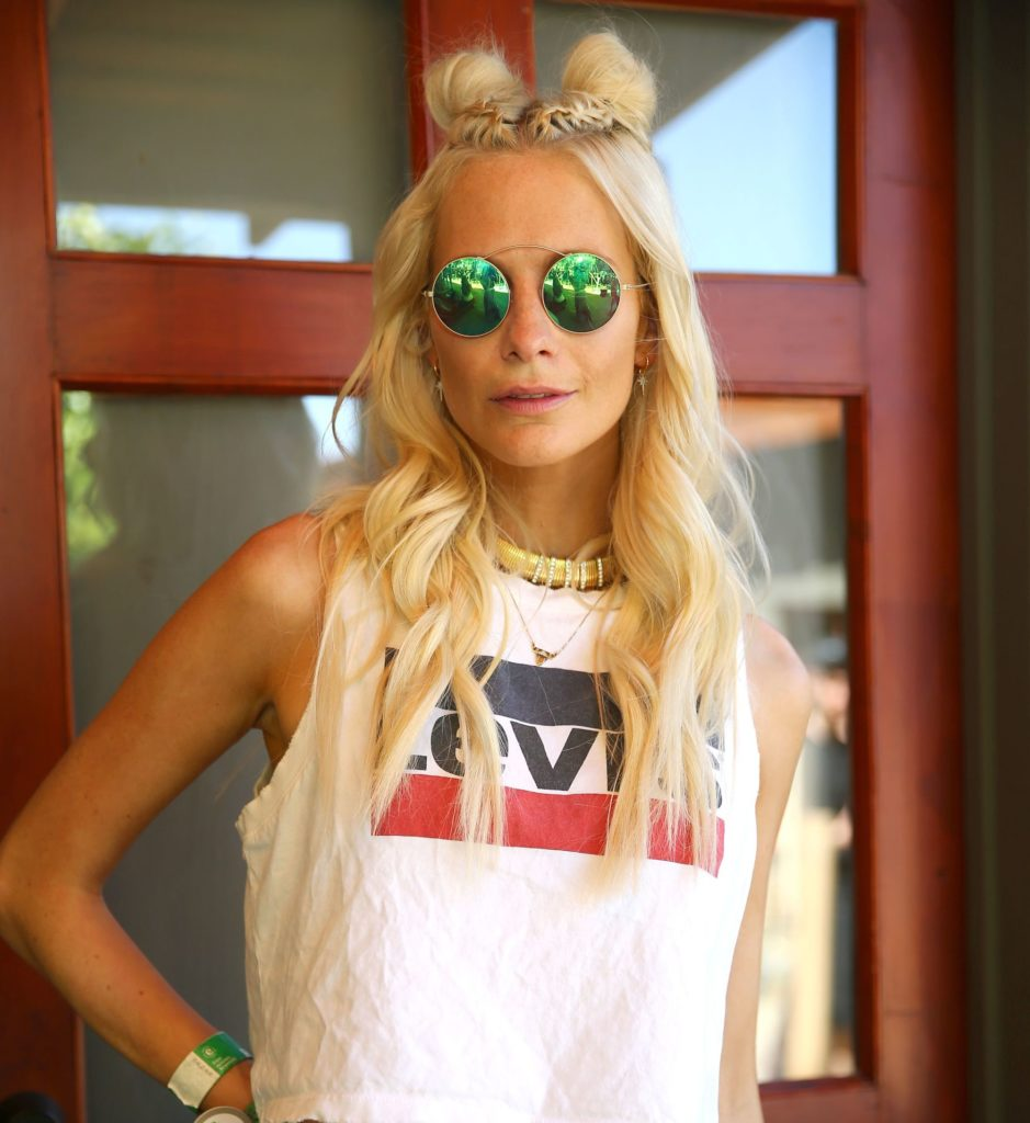latest hairstyles for long hair: space buns as demonstrated by Poppy Delevingne coachella hair