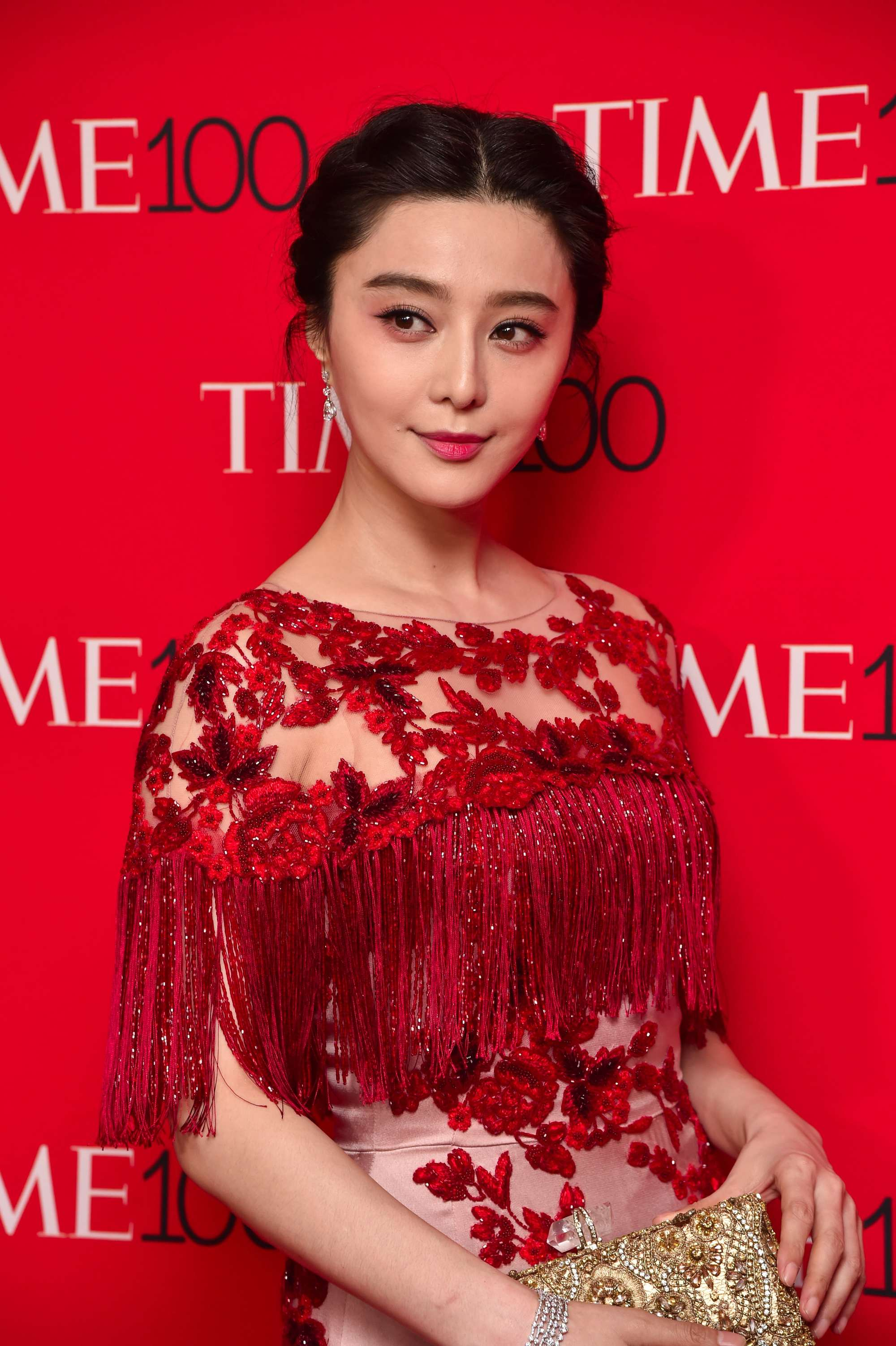 fan bing bing with twisted updo and red dress at time gala event