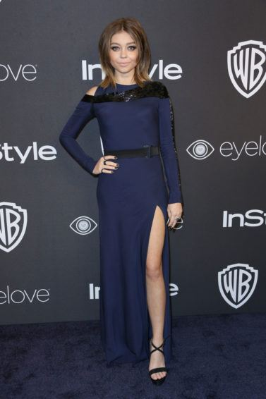 sarah hyland at a golden globes after party in a navy dress with brunette hair