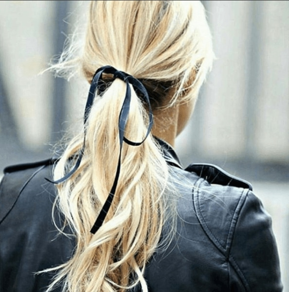 back view image of a woman with long blonde hair with a dark black ribbon - long hairstyles 2017