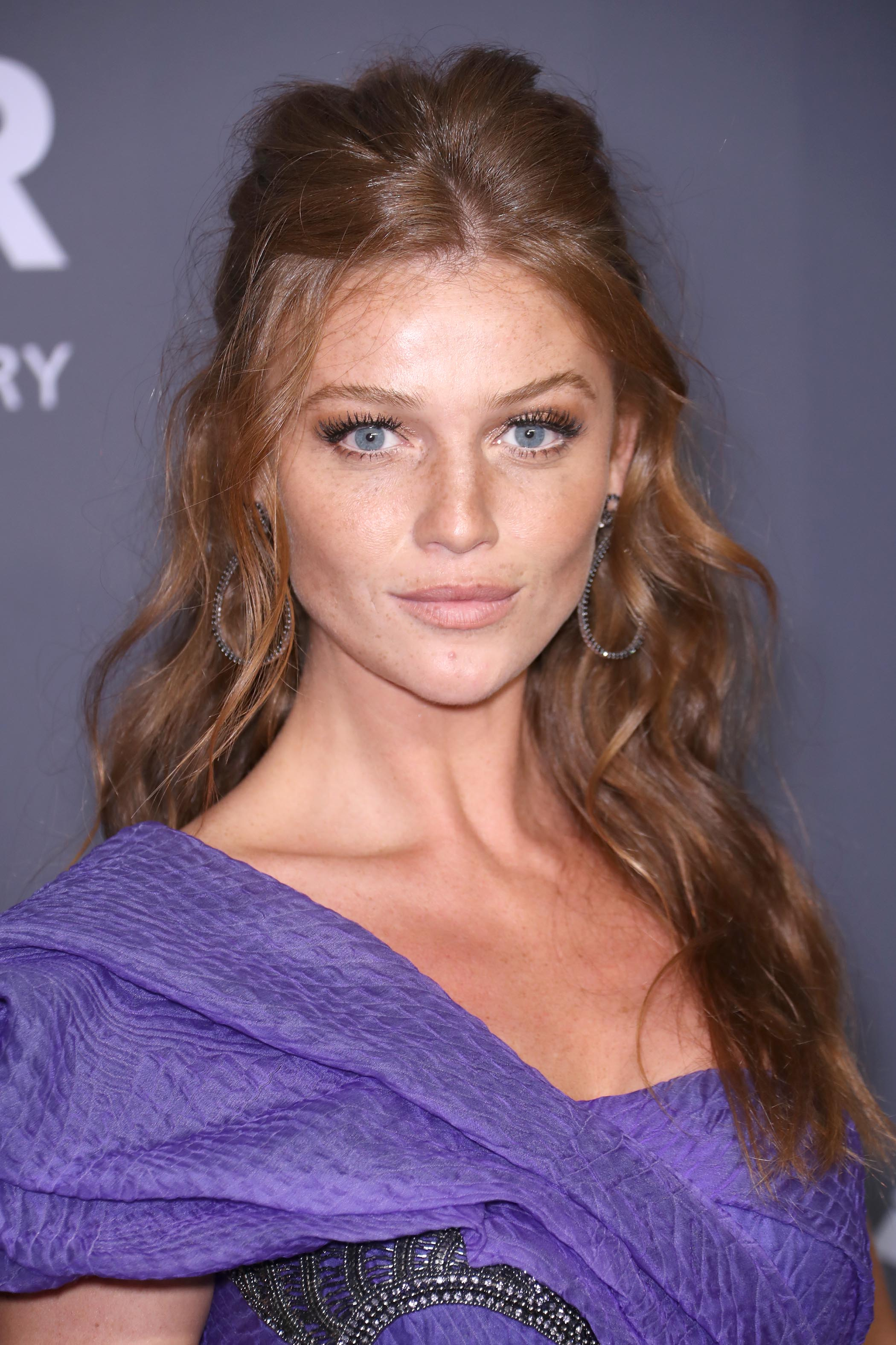 Long hairstyle ideas: Cintia Dicker with long red-brown hair styled into a voluminous half-up hairstyle