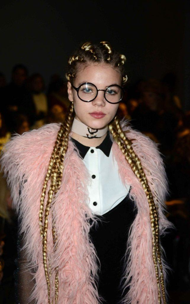 model yael meier with golden ghana braids backstage with glasses and pink fur jacket