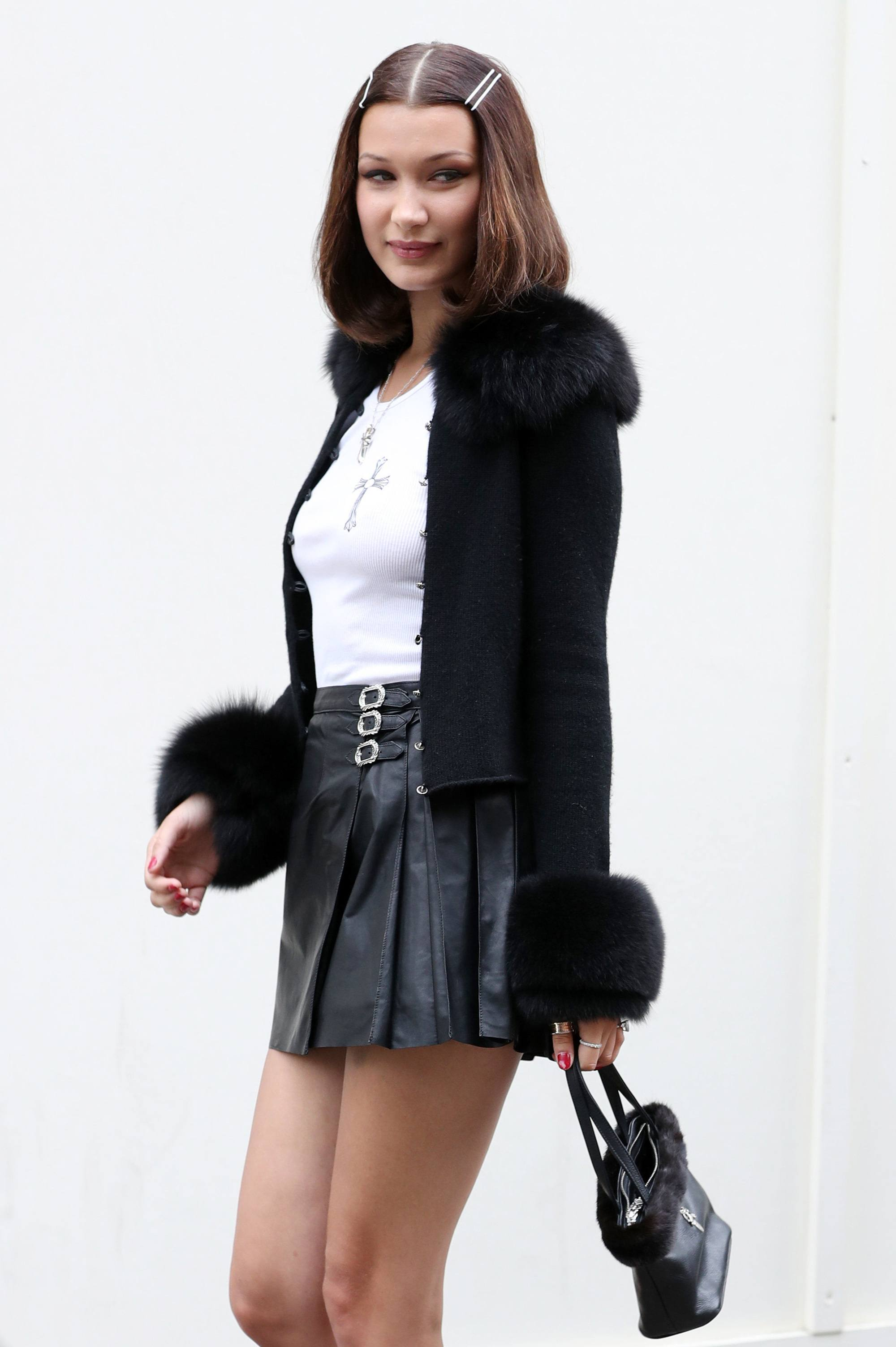bella hadid with hair clips and a middle parted long bob