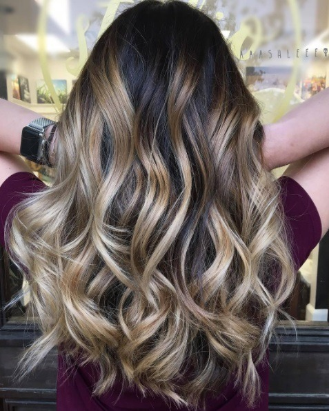 Woman With Brunette Curly Hair Lighter Blonde Balayage