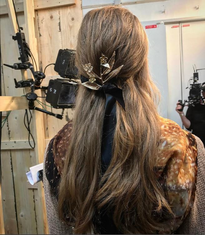 Chanel Cruise hair - half,up hairstyle with gold accessory