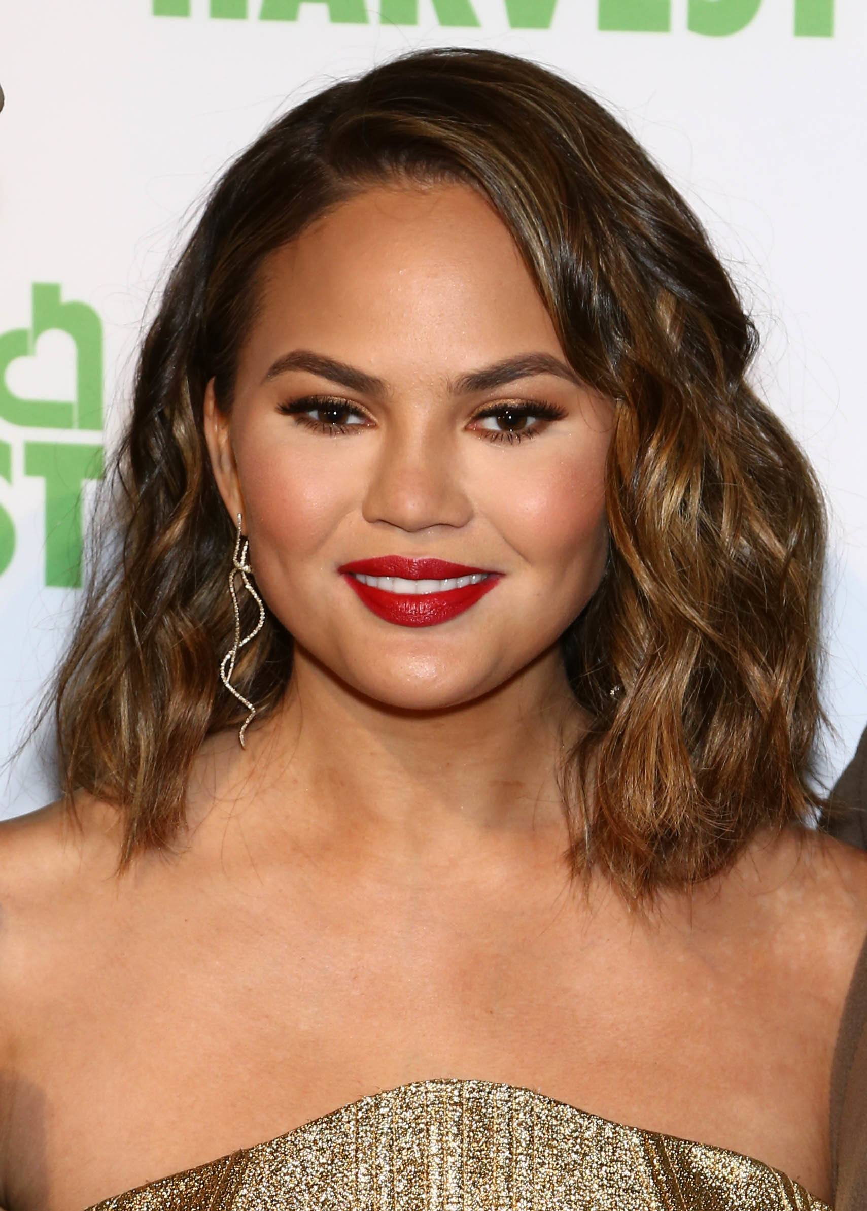 chrissy teigen with a brown balayage long bob hairstyle
