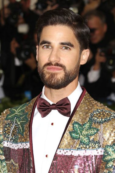 glee and american crime story actor darren criss at the 2018 met gala with gelled side parted hair