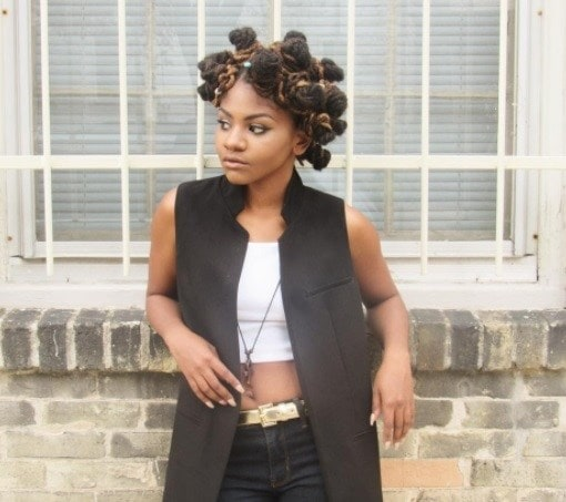 woman with faux locs in bantu knots