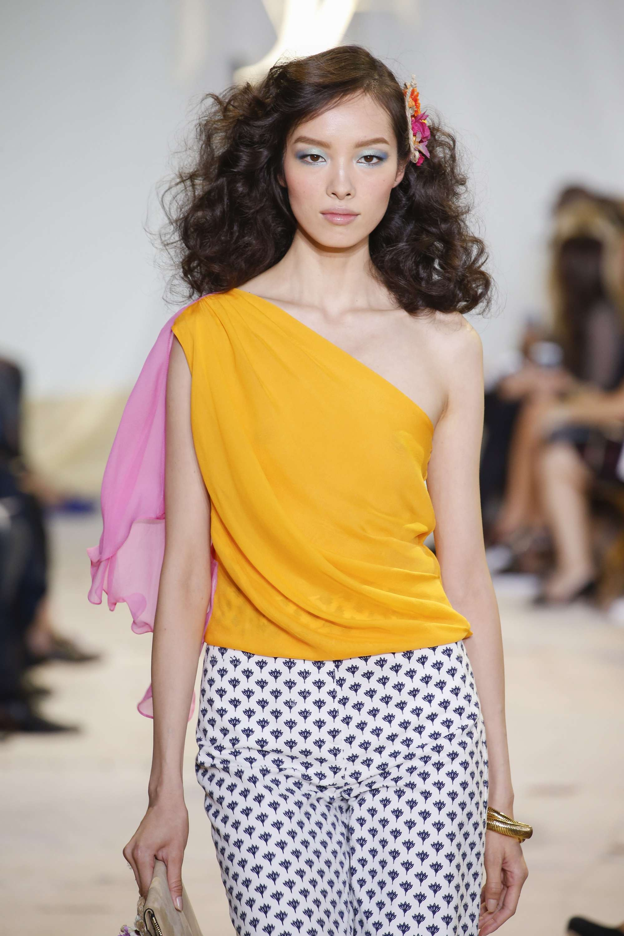DVF tight waves hairstyle on brunette model. Indigital