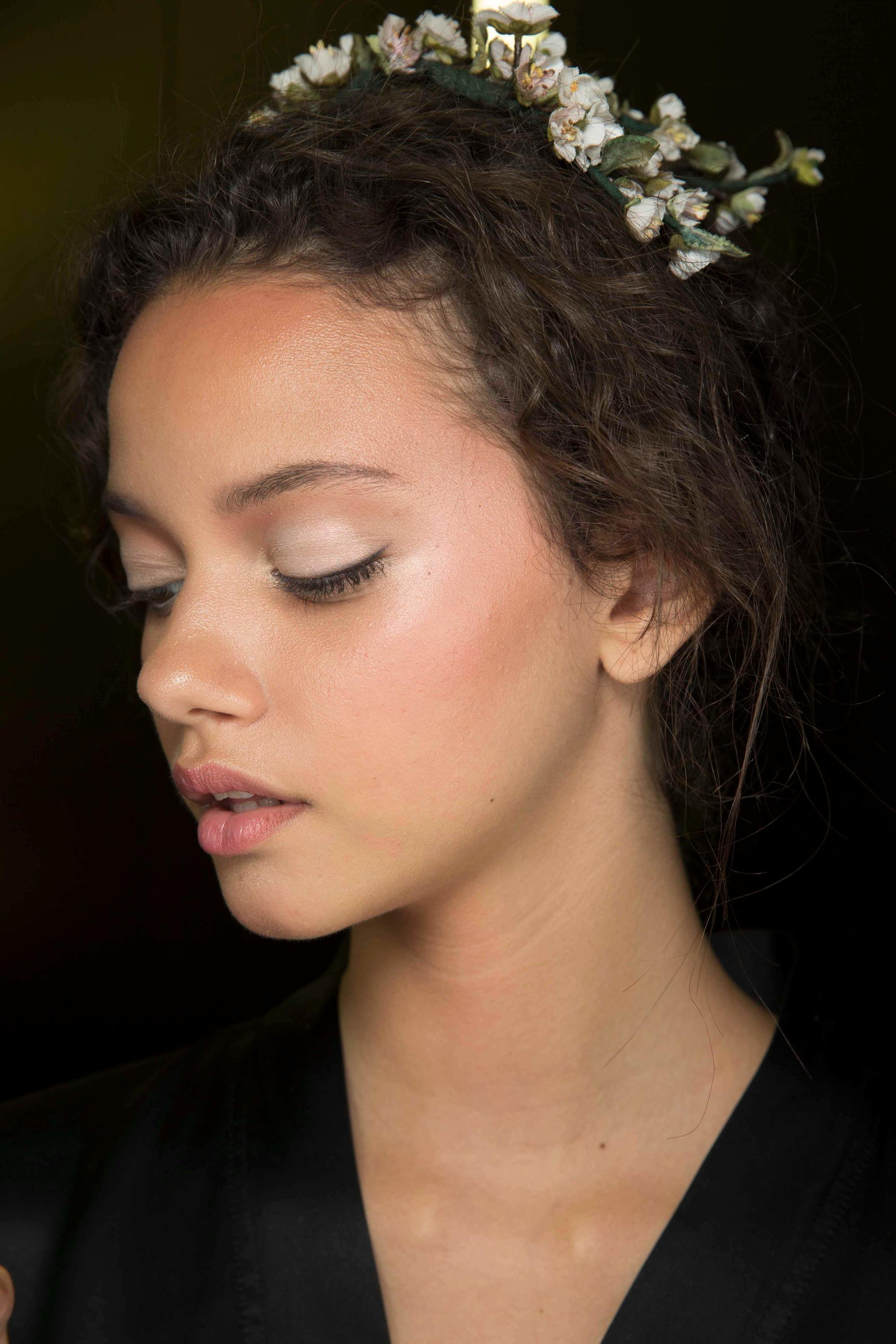 Curly haired model with floral headband
