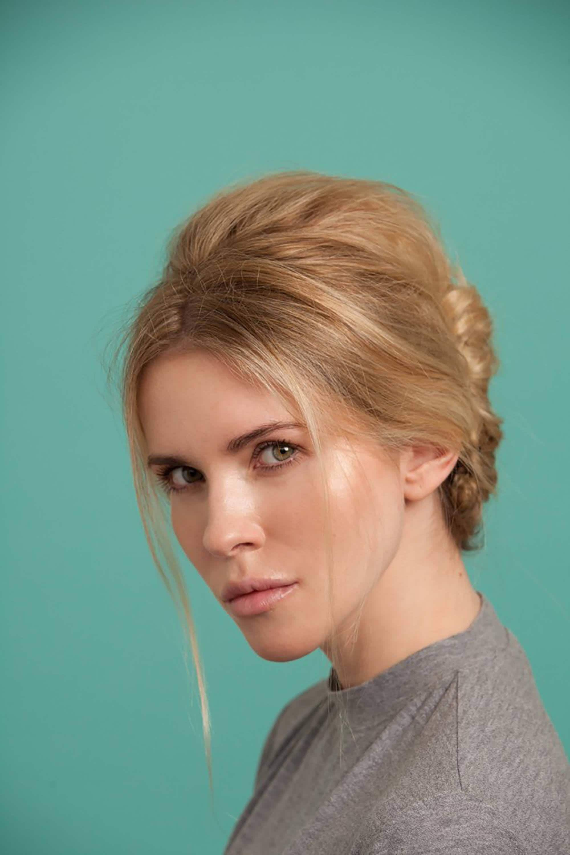 blonde model with her hair in a bouffant beehive french twist hairstyle