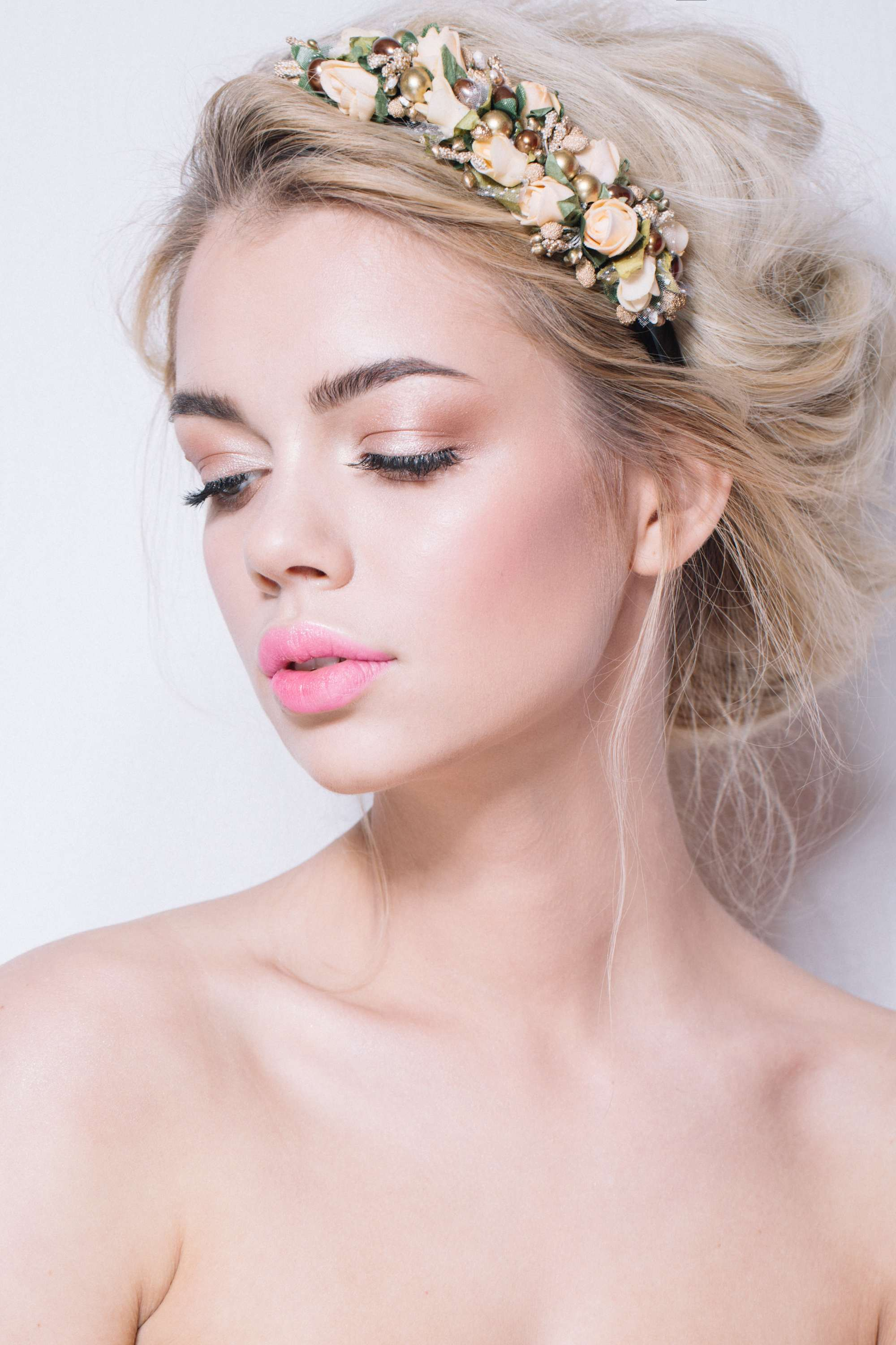 Blonde hair in loose updo finished with floral headband