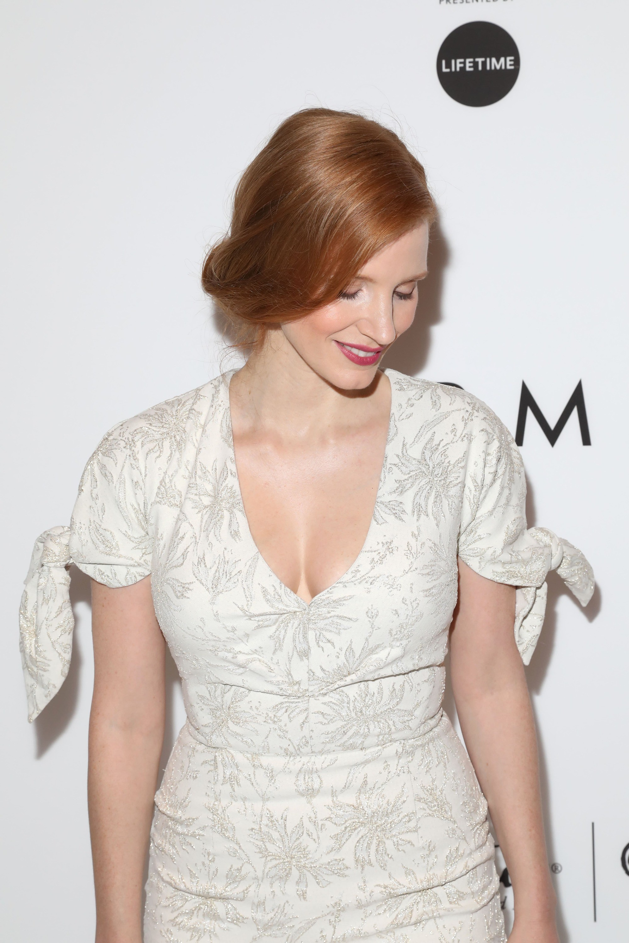 Jesscia Chastain - loose updo - strawberry blonde hair