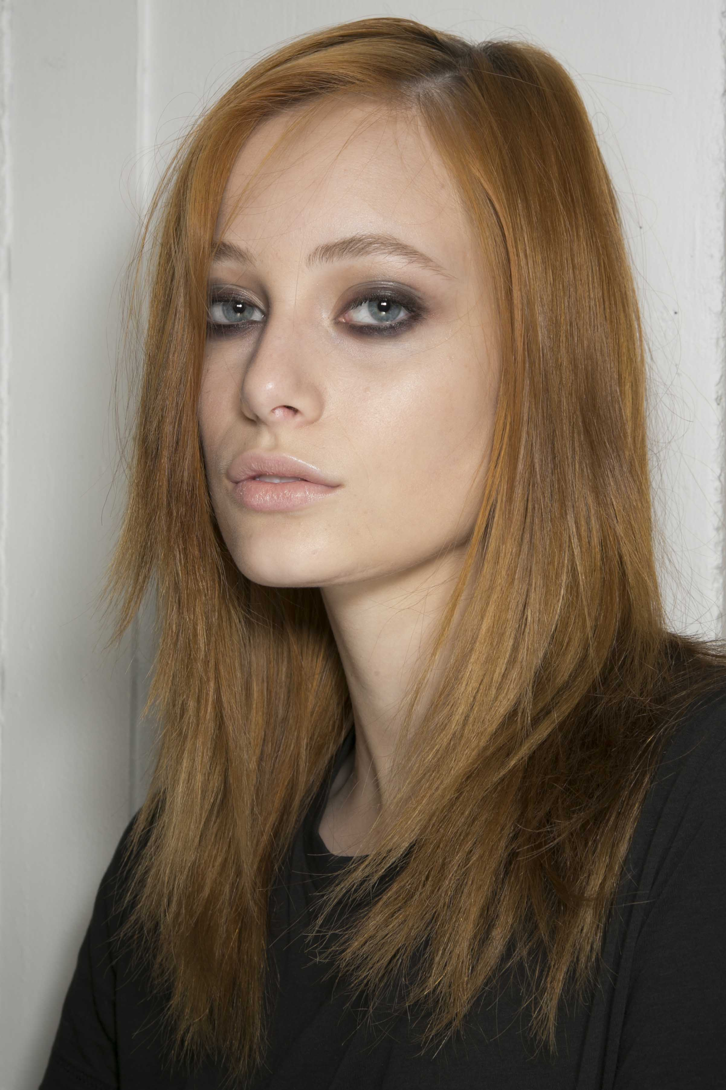 Model with mid length straight strawberry blonde hair