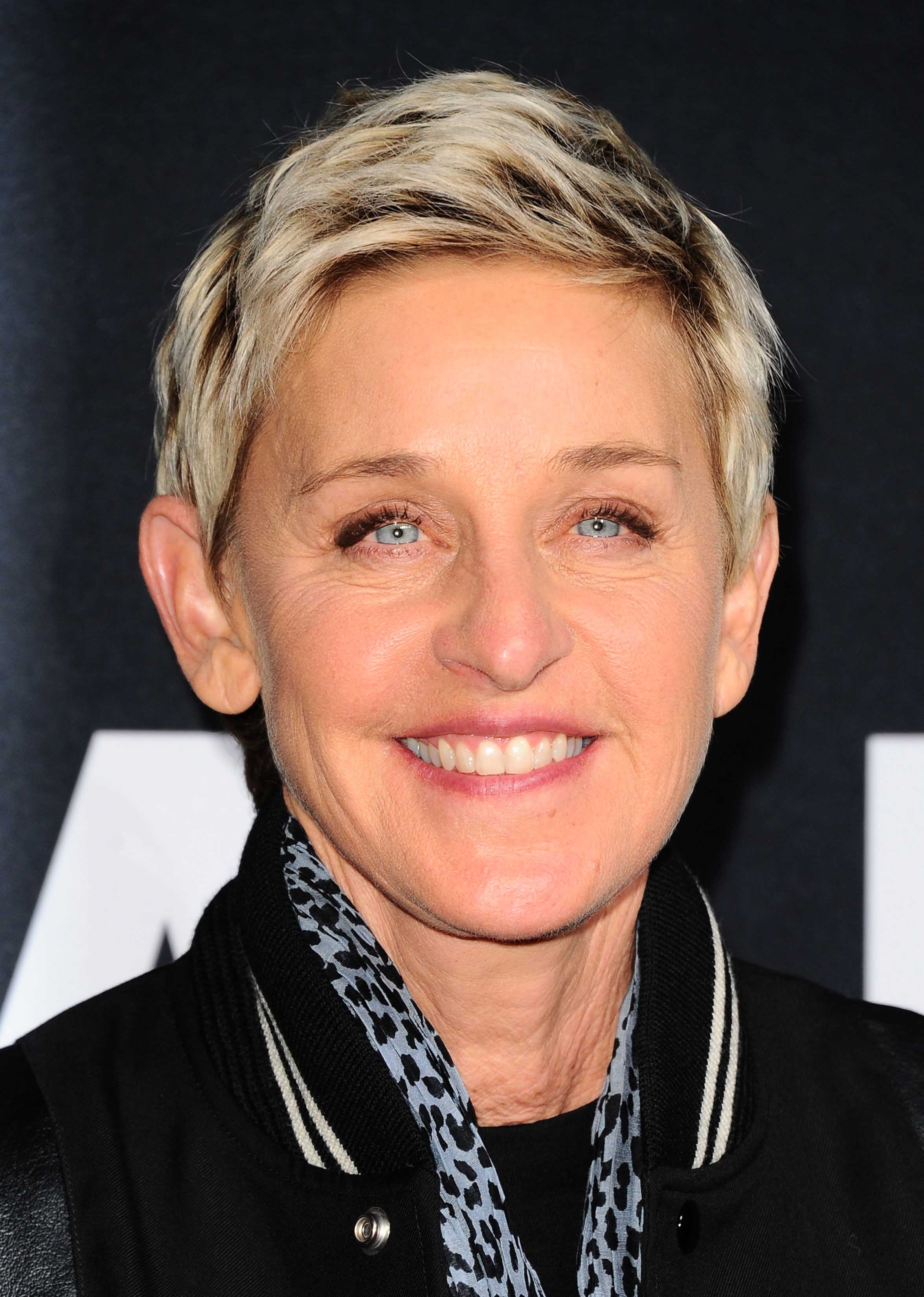 Blonde pixie crop with dark roots hairstyles Ellen DeGeneres. Credit Rex by Shutterstock