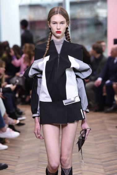 model on the prada resort runway with pigtails hairstyle