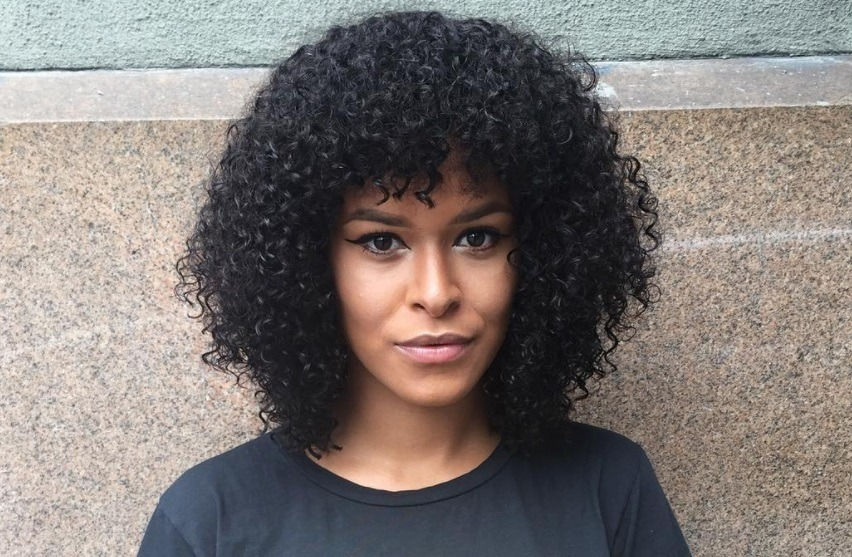 Layered bob: Woman with naturally curly hair with a bob cut and fringe
