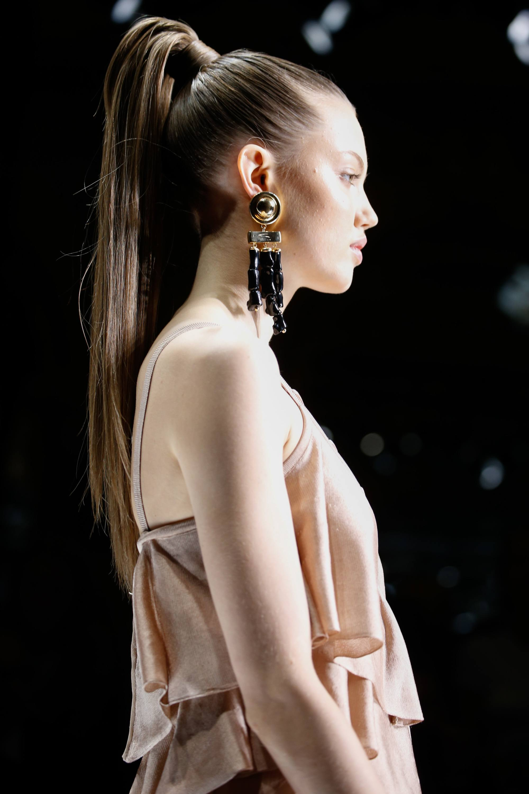 brunette balmain model on the runway with a structured high ponytail