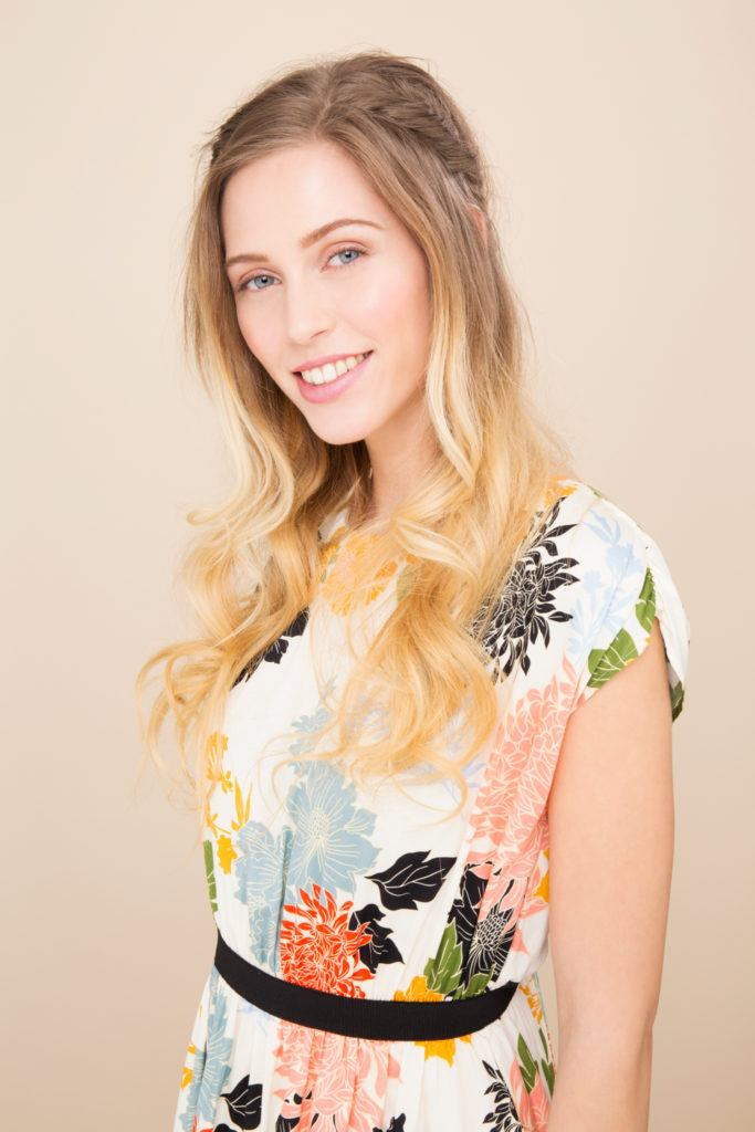 Boots x ATH simple holiday hairstyles: Blonde model with loose waves and a braided crown