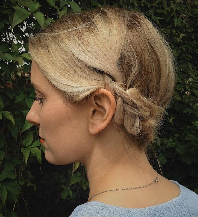 , mother of the bride hairstyles for short hair: woman with low braided hairstyle